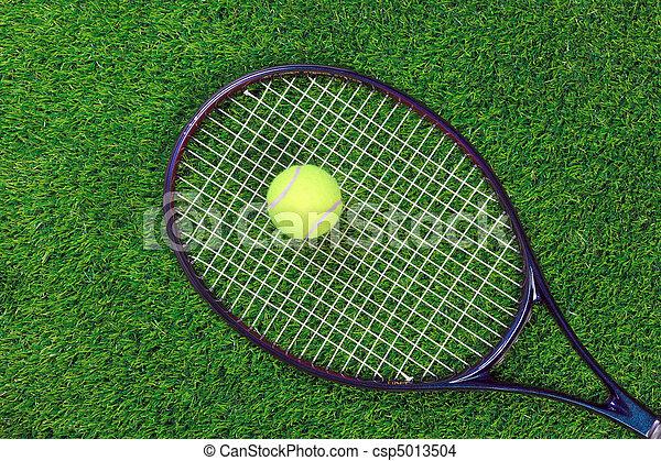 Tennis raquet and ball on grass - csp5013504