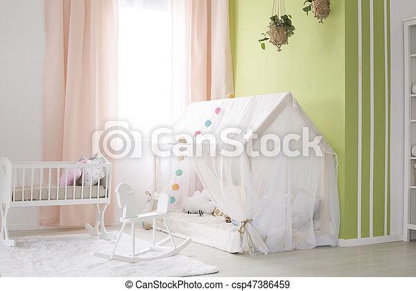 Tent in baby room - csp47386459
