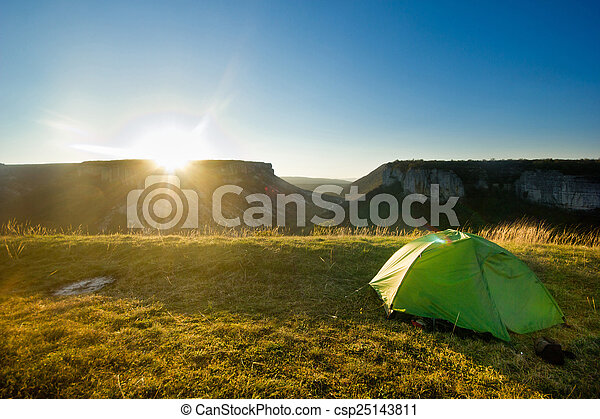 tent in the mountains at sunrise - csp25143811
