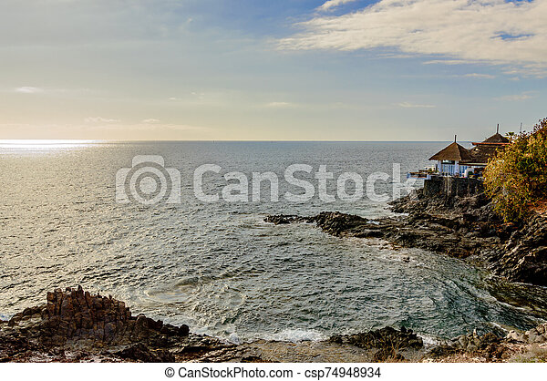 Terrace Of A Payoza On A Cliff With A Privileged View Of The Infinite Ocean At Sunset Beach Las Americas. April 11, 2019. Santa Cruz De Tenerife Spain Africa. Travel Tourism Street Photography. - csp74948934