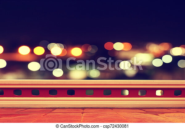 terrace with bokeh light in city night time background - csp72430081