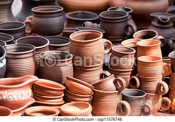 Terracotta ceramics mugs souvenirs street handicraft market - csp11576746