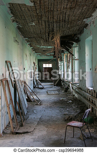 Terrible destroyed interior of old building. Destructed roof is going to fall down - csp39694988