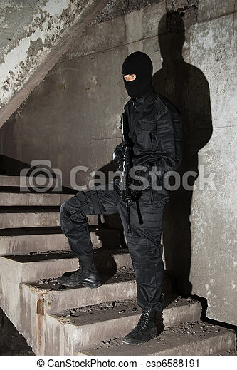 Terrorist in black mask on staircase - csp6588191