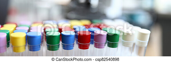 Test tubes with colored caps are in laboratory - csp82540898