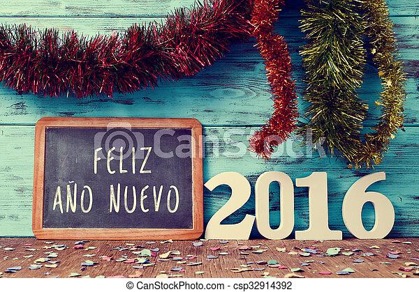 Text feliz ano nuevo 2016, happy new year 2016 in spanish. Tinsel of ...