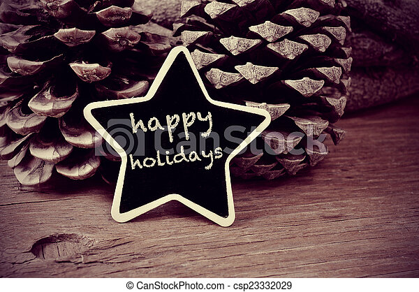 text happy holidays in a star-shaped blackboard, in black and wh - csp23332029