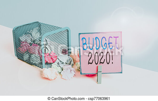 Text sign showing Budget 2020. Conceptual photo estimate of income and expenditure for next or current year Trash bin crumpled paper clothespin empty reminder office supplies tipped. - csp77063961
