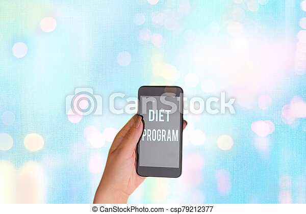 Text sign showing Diet Program. Conceptual photo practice of eating food in a regulated and supervised fashion. - csp79212377