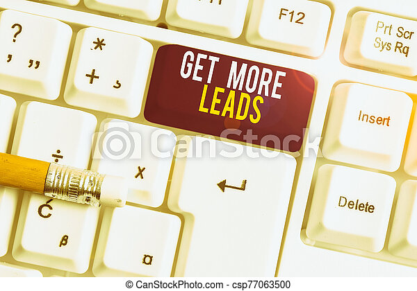 Text sign showing Get More Leads. Conceptual photo Look for new clients customers followers Marketing strategy White pc keyboard with empty note paper above white background key copy space. - csp77063500