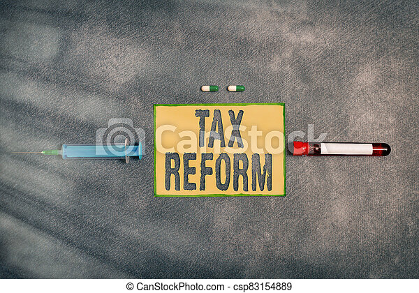Text sign showing Tax Reform. Conceptual photo government policy about the collection of taxes with business owners Extracted blood sample vial with medical accessories ready for examination. - csp83154889