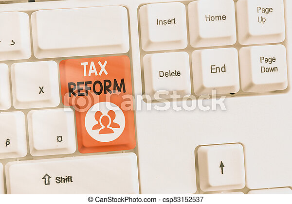 Text sign showing Tax Reform. Conceptual photo government policy about the collection of taxes with business owners Different colored keyboard key with accessories arranged on empty copy space. - csp83152537