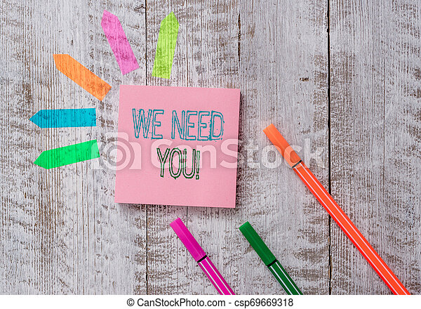 Text sign showing We Need You. Conceptual photo asking someone to work together for certain job or target Plain note paper and line arrow stickers on the top of wooden table desk. - csp69669318