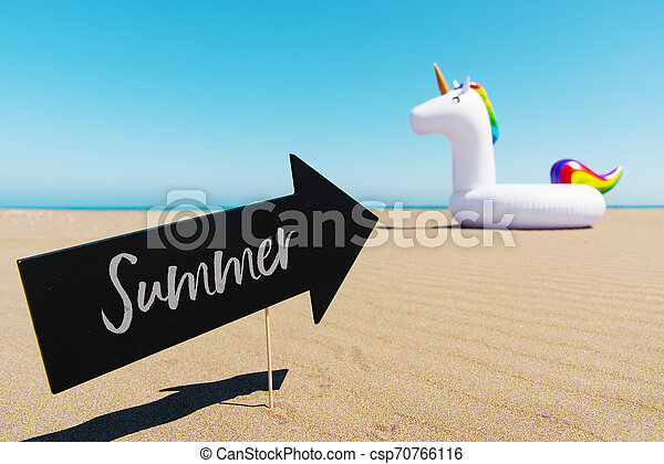 text summer and unicorn on the beach - csp70766116