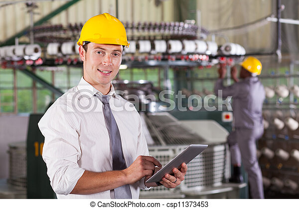 textile factory manager using tablet computer - csp11373453