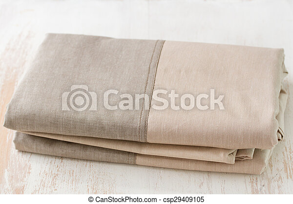 textile on white wooden background - csp29409105