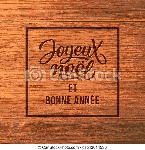 Joyeux noel texto madera. Tarjeta de Navidad - csp43014536