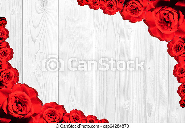 Texture of red roses on a wooden background. Valentines background - csp64284870