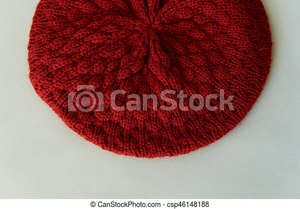 Texture red knitted beret made of wool. - csp46148188