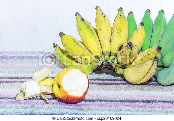 Thai Bananas and Apple Still Life, bite Banana and Apple - csp20169024