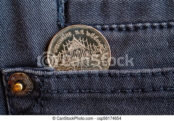 Thai coin with a denomination of 5 baht in the pocket of gray denim jeans - csp56174654