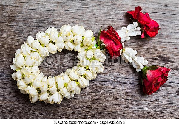 Thai flower garland on wooden table - csp49332298