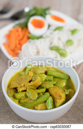 Thai food spicy pork and vegetable Parkia speciosa curry in coconut milk and Thai rice flour noodles - csp63030087