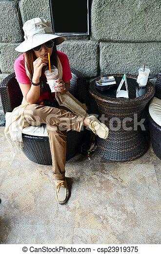 Thai woman drink coffee - csp23919375