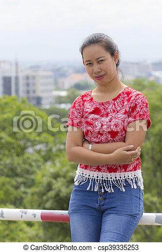 Thai woman portrait with Chiangmai city view - csp39335253