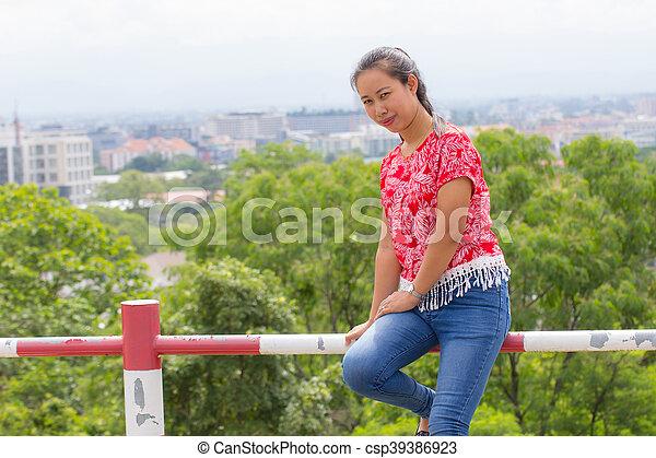 Thai woman portrait with Chiangmai city view - csp39386923