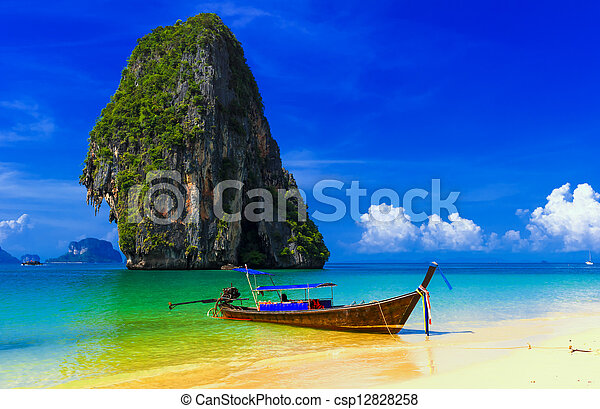 Thailand exotic tropical beach. Blue sky, sand and traditional boat - csp12828258