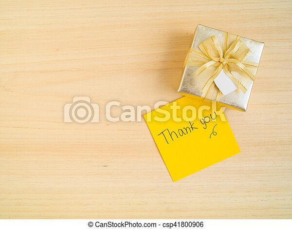 thank you words on sticky note with gift box hand writing thank