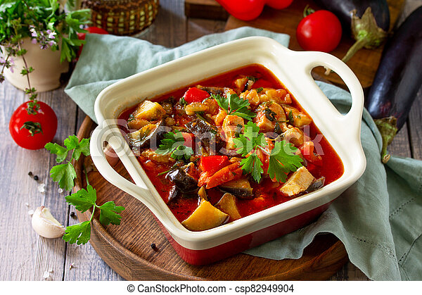 Thanksgiving Autumn Menu. Stewed meat with eggplant and eggplant vegetables on a rustic table. - csp82949904