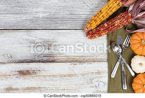 Thanksgiving Dinner Setting On Rustic White Table With Colorful Autumn Decorations