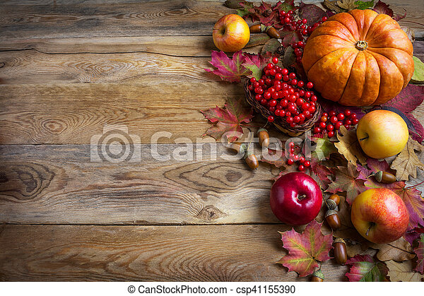 Thanksgiving greeting background with orange pumpkins, apples and fall leaves - csp41155390