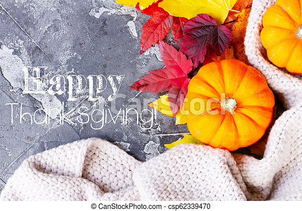 Thanksgiving pumpkins with fall leaves - csp62339470