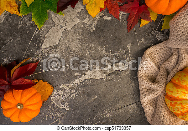 Thanksgiving pumpkins with fall leaves - csp51733357