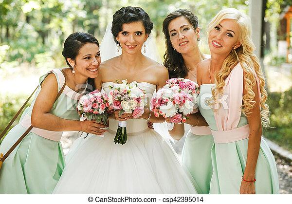 The adorable bride with bridesmaids - csp42395014