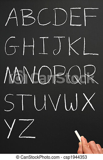 The alphabet in capitals written with white chalk on a blackboard. - csp1944353