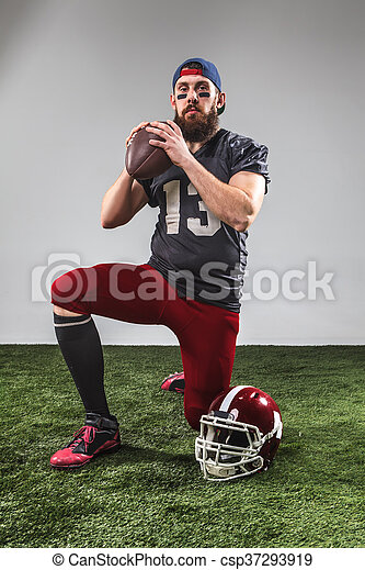 The american football player with ball - csp37293919
