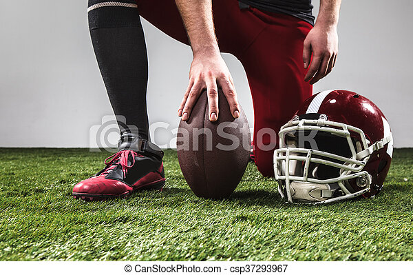 The american football player with ball - csp37293967