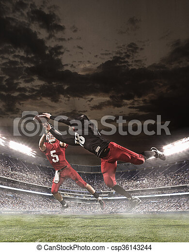 The american football players in action - csp36143244
