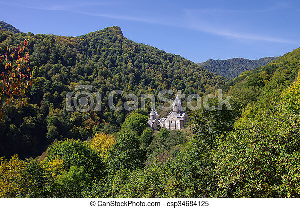 The ancient Haghartsin monastery is located near the town of Dilijan, in a wooded valley. - csp34684125