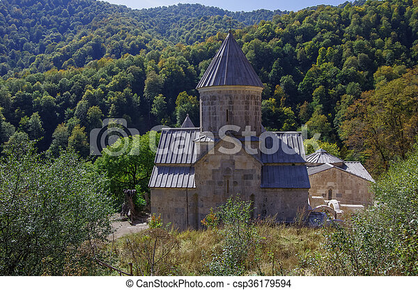 The ancient Haghartsin monastery is located near the town of Dilijan, in a wooded valley. - csp36179594