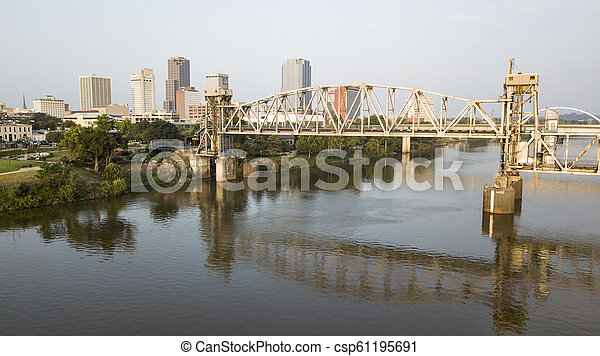 The Arkansas River Flows by Waterfront of Little Rock the State Capitol - csp61195691