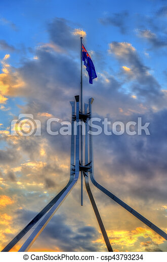 The Australian flag on top of Parliament House in Canberra - csp43793234