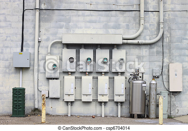 The back wall of a large coalition of businesses and the electric power, telephone, cable and gas distribution systems that they operate off of. - csp6704014