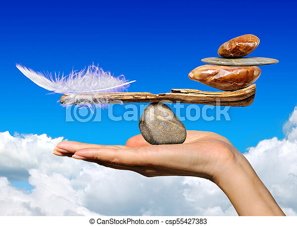 The balance of the bird's feather and stones - csp55427383