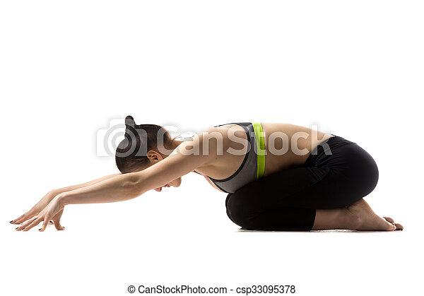 the balasana pose sporty fit beautiful young brunette