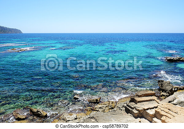The beach and turquoise water on Mallorca island, Spain - csp58789702